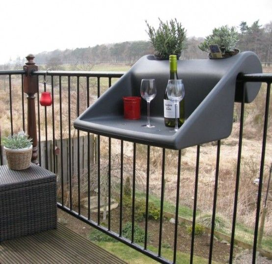 use fold-down tables in your balcony